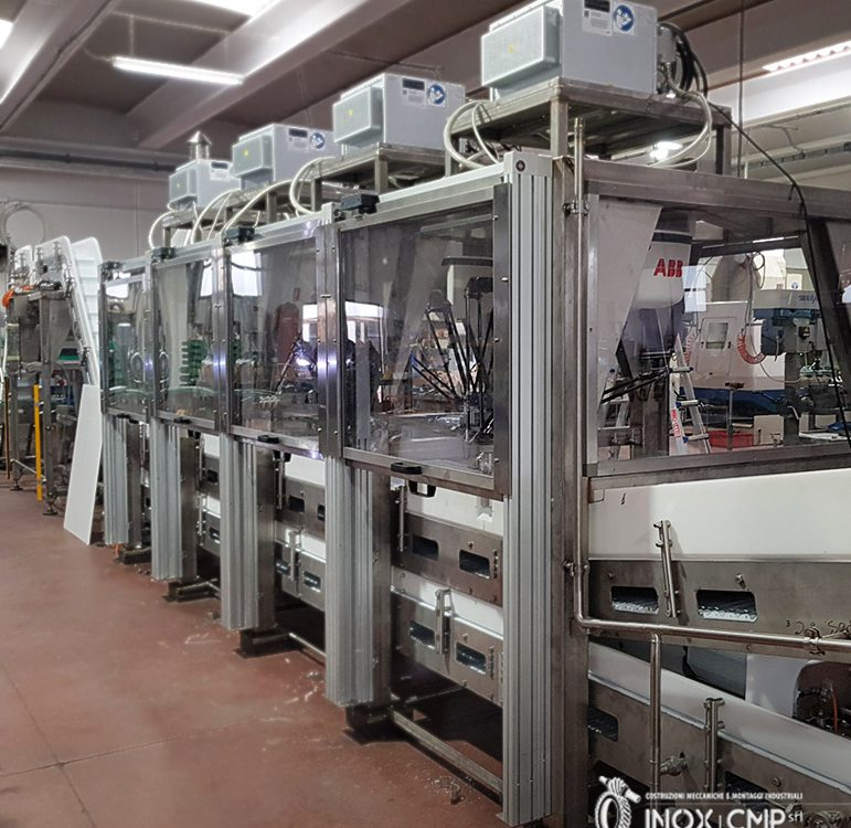 Automatic packaging line2 of frosty food in boxes composed by 4 robots, conveyors and stainless steel structures • Inox Cmp srl©